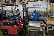 Samara, Russia, 25/02/2005..The Samara Electroschit {Electroshield] plant, one of Russia's leading electrical engineering companies. Production line staff using equipment supplied by Swiss firm Bystronic.