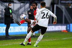 Matthew Olosunde of Rotherham United hoofs the ball past Lee Buchanan of Derby County - Mandatory by-line: Ryan Crockett/JMP - 16/01/2021 - FOOTBALL - Pride Park Stadium - Derby, England - Derby County v Rotherham United - Sky Bet Championship