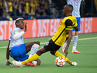 BERN, SWITZERLAND - SEPTEMBER 14: Christopher Martins of BSC Young Boys tackles Paul Pogba of Manchester United during the UEFA Champions League group F match between BSC Young Boys and Manchester United at Stadion Wankdorf on September 14, 2021 in Bern, Switzerland. (Photo by FreshFocus/MB Media)
