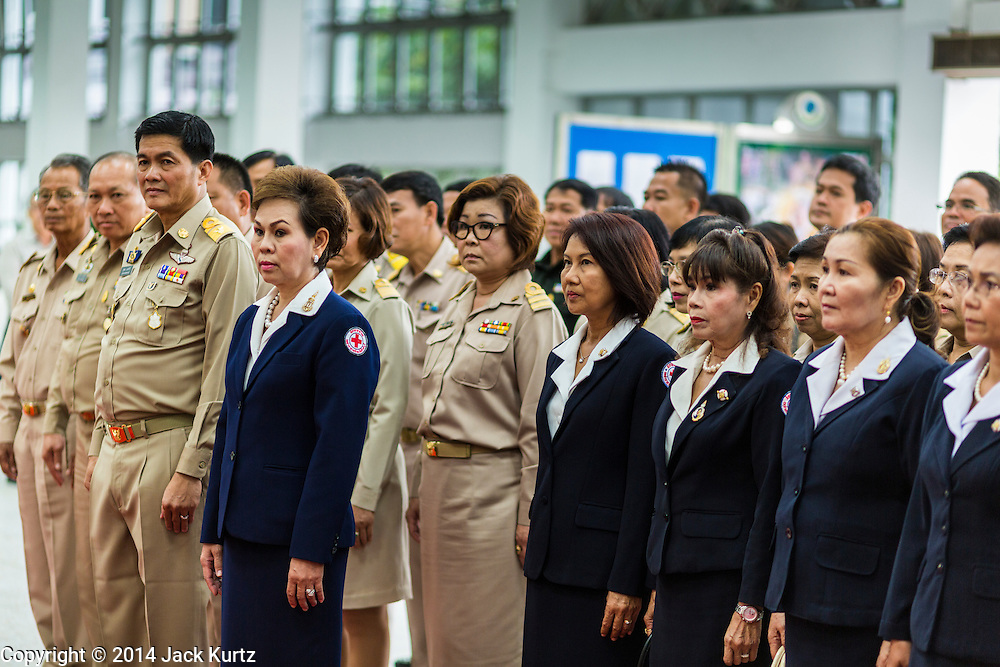 09 OCTOBER 2014 - BANGKOK, THAILAND: Thai civil servants and representatives of the Red Cross gather to pray for Bhumibol Adulyadej, the King of Thailand in the lobby at Siriraj Hospital. The King has been hospitalized since Oct. 4 and underwent emergency gall bladder removal surgery Oct. 5. The King is also known as Rama IX, because he is the ninth monarch of the Chakri Dynasty. He has reigned since June 9, 1946 and is the world's longest-serving current head of state and the longest-reigning monarch in Thai history, serving for more than 68 years. He is revered by the Thai people and anytime he goes into the hospital thousands of people come to the hospital to sign get well cards.   PHOTO BY JACK KURTZ