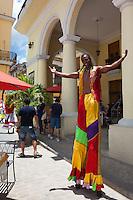 Street performers passing through Plaza Vieja in Old Havana, Cuba.