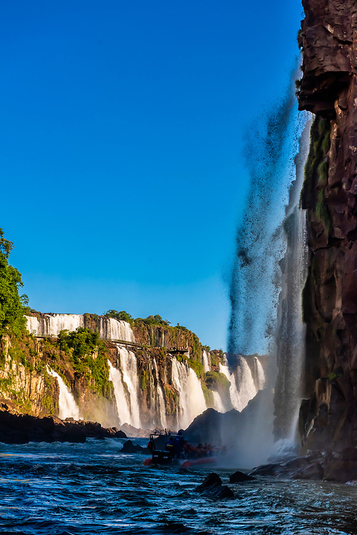 View from the Iguazu River to Iguazu Falls (Iguacu in Portugese), on the border of Brazil and Argentina. It is one of the New 7 Wonders of Nature and is a UNESCO World Heritage Site. There are 275 waterfalls total which make up the largest waterfalls in the world.