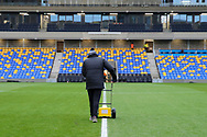 AFC Wimbledon member of staff painting the lines prior to kick off in front of main stand during the EFL Sky Bet League 1 match between AFC Wimbledon and Sunderland at Plough Lane, London, United Kingdom on 16 January 2021.