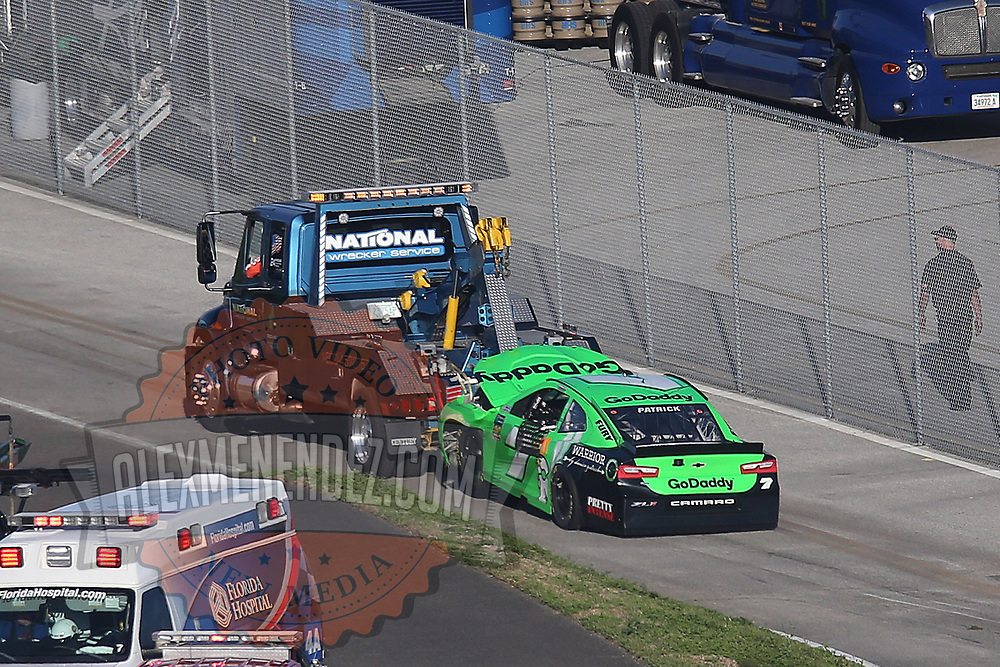Danica Patrick's (7) GoDaddy Chevrolet is seen getting towed to the garage after crashing with Chase Elliott, driver of the (9) NAPA Autoparts Chevrolet, and Kasey Kahne, driver of the (95)Procore Chevrolet during the 60th Annual NASCAR Daytona 500 auto race at Daytona International Speedway on Sunday, February 18, 2018 in Daytona Beach, Florida. This would be Patrick's final NASCAR race.  (Alex Menendez via AP)