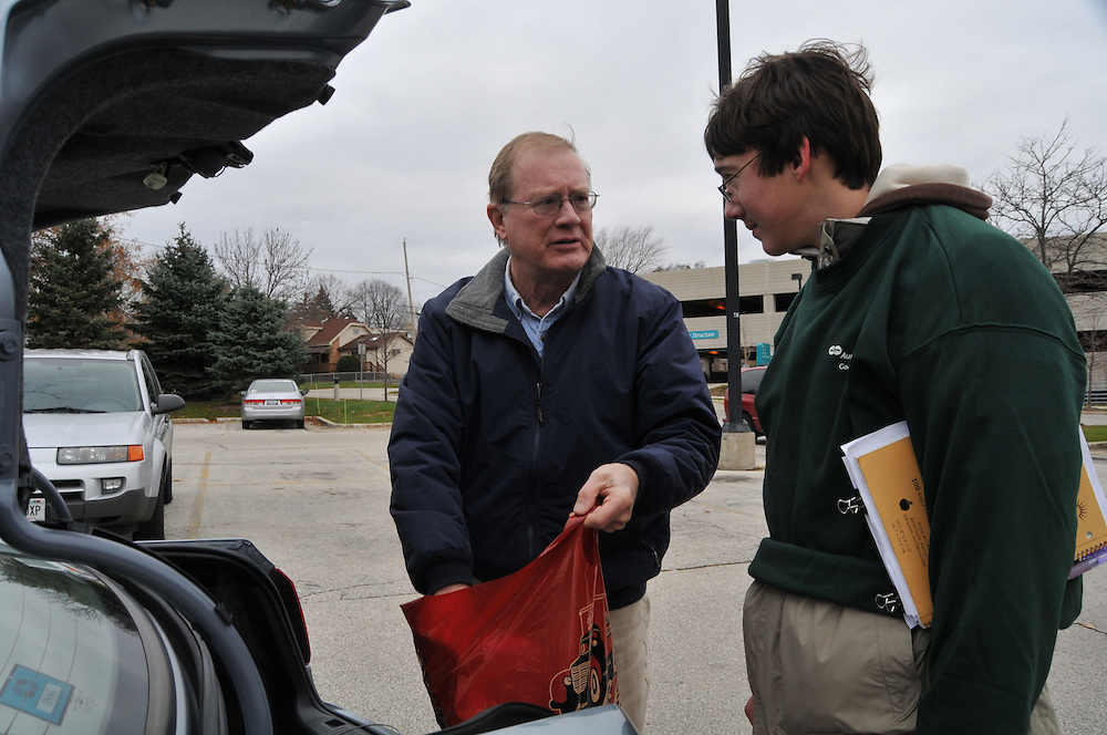 Andrew Stiles collects items from Ralph Kirsch to be donated during Good Neighbor Day, Saturday Nov. 15 2008.  The program was organized by Andrew a boy scout, age 16, who has been diagnosed with muscular dystrophy, a disease that causes progressive muscle  weakness.
