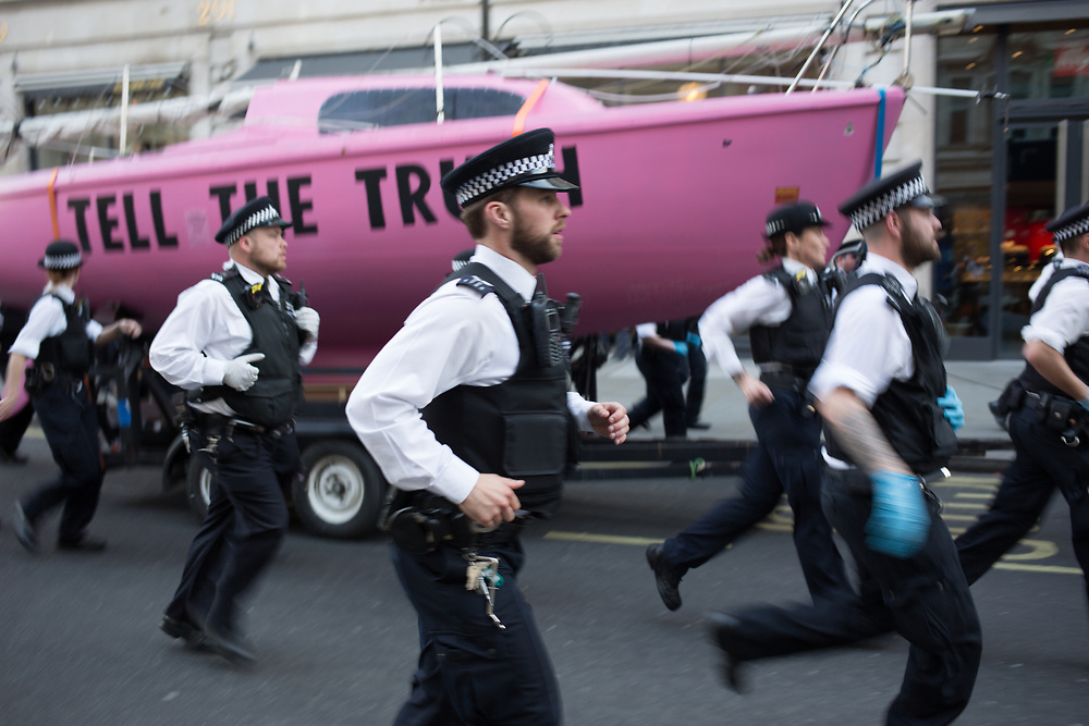 Police remove the Tell The Truth boat, named Berta Cáceres, from Oxford Circus