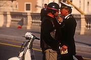 A scooter rider gets close to a traffic policeman during an altercation in the Italian capital, on 3rd November 1999, in Rome, Italy.