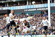 Tottenham Hotspur's Harry Kane (2nd left) heads the ball . Barclays premier league match ,Tottenham Hotspur v Aston Villa at White Hart Lane in Tottenham, London  on Sunday 11th May 2014.<br /> pic by John Patrick Fletcher, Andrew Orchard sports photography.