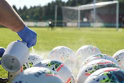 Staff member is disinfecting the balls before the football match between NK Aluminij and NK Bravo in 32. Round of Prva liga Telekom Slovenije 2019/20, on July 8, 2020 in Sportni park NK Aluminij Stadion, Kidricevo, Slovenia. Photo by: Milos Vujinovic /Sportida