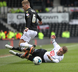 Richard Keogh of Derby County tackles Josh Vela of Bolton Wanderers (L) - Mandatory by-line: Jack Phillips/JMP - 09/04/2016 - FOOTBALL - iPro Stadium - Derby, England - Derby County v Bolton Wanderers - Sky Bet Championship