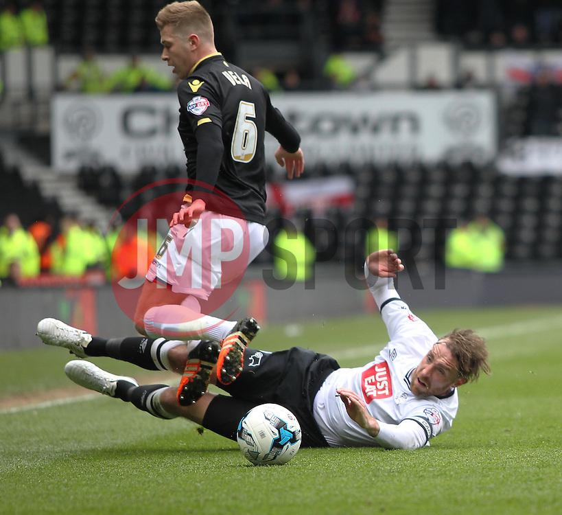 Richard Keogh of Derby County tackles Josh Vela of Bolton Wanderers (L) - Mandatory by-line: Jack Phillips/JMP - 09/04/2016 - FOOTBALL - iPro Stadium - Derby, England - Derby County v Bolton Wanderers - Sky Bet Championship