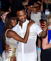 Oti Mabuse and Johannes Radebe arriving at the red carpet launch of Strictly Come Dancing 2019, held at BBC TV Centre in London, UK.