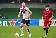 Dundalk's Chris Shields with Rapid Wien's Taxiarchis Fountas during the Europa League Round 1 match between Dundalk and SK Rapid Wien at Aviva Stadium, Dublin, Ireland on 26 November 2020.