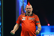 Peter Wright celebrates winning a leg during the PDC Unibet Premier League darts at Marshall Arena, Milton Keynes, United Kingdom on 24 May 2021.