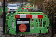 Due to works carried out by contractors on behalf of gas network SGN, plastic barriers block the pavement along Ferndene Road (correct spelling) in Herne Hill SE24, on 11th February 2019, in London, England.