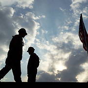 U.S. Forces raise U.S. flag at the U.S. Army MASH Unit in Muzzafarabad just two weeks after setting up the unit.