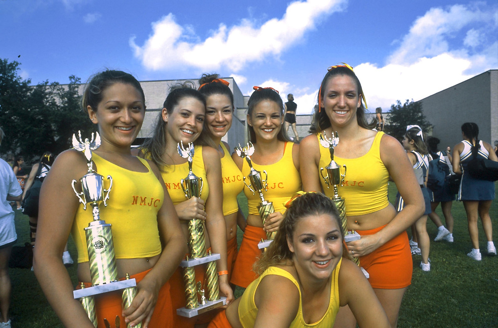 San Marcos, Texas Cheerleaders pose with their trophies after the Universal Cheerleaders Association college camp awards. -   ©Bob Daemmrich /The Image Works