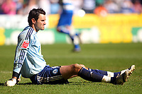 Photo: Andrew Fosker/Richard Lane Photography. Reading v Peterborough United. Coca Cola Championship. 17/04/2010. A horrible day for Peterborough's keeper Joe Lewis (Capt)  as he sits dejected  on the floor  after conceding Reading's 5th to Shane Long.