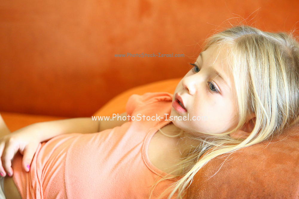 Young girl of 4 engrossed in a TV show Model release available