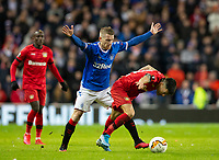 Football - 2019 / 2020 UEFA Europa League - Round of Sixteen, First Leg: Rangers vs. Bayer 04 Leverkusen<br /> <br /> Steven Davis of Rangers vies with Charles Aranguiz of Bayer Leverkusen, at Ibrox Stadium, Glasgow.<br /> <br /> COLORSPORT/BRUCE WHITE