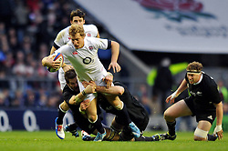 Billy Twelvetrees (England) takes on the New Zealand defence - Photo mandatory by-line: Patrick Khachfe/JMP - Tel: Mobile: 07966 386802 16/11/2013 - SPORT - RUGBY UNION -  Twickenham Stadium, London - England v New Zealand - QBE Autumn Internationals.