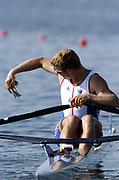 20040814 Olympic Games Athens Greece [Rowing]<br /> Photo  Peter Spurrier <br /> GBR M1X Ian Lawson at the start and collecting weed from beneath his boat.<br /> email;  images@intersport-images.com<br /> Tel +44 7973 819 551<br /> T<br /> <br /> <br /> [Mandatory Credit Peter Spurrier/ Intersport Images]