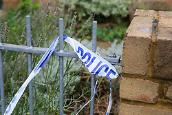 © Licensed to London News Pictures. 14/10/2019. London, UK. Leftover of a police tape on Herbert Road in Tottenham, North London where a 20 year old man was stabbed and is fighting for his life in hospital. Police were called to Herbert Road in north London at 10.41pm on Sunday 13 October following reports of a stabbing. Photo credit: Dinendra Haria/LNP
