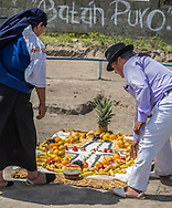 A Shaman and his Assistant preparing the food offering for a Kapak Raymi Celebration
