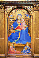 Gothic panel of the (Virgin Mary) Madonna of Humility. Polychrome and gold leaf on wood, circa 1433-1435. The Virgin is seated on a cushion on the floor holding the baby Jesus. She hand a jug with roses a symbol of motherhood and purity. Behind her a gold curtain is held by three angels, while two others are sitting on the floor are playing the organ and lute. The skill of the use of light and shade and the fine brushwork points to an artist of great skill using the Quattrocento style. The piece has been identified as that described by the writer on art Giorgia Vasari in 1568 which was owned Gondi family in Florence.. Inv MNAC 212817. National Museum of Catalan Art (MNAC), Barcelona, Spain .<br /> <br /> <br /> If you prefer you can also buy from our ALAMY PHOTO LIBRARY  Collection visit : https://www.alamy.com/portfolio/paul-williams-funkystock/gothic-art-antiquities.html  Type -     MANAC    - into the LOWER SEARCH WITHIN GALLERY box. Refine search by adding background colour, place, museum etc<br /> <br /> Visit our MEDIEVAL GOTHIC ART PHOTO COLLECTIONS for more   photos  to download or buy as prints https://funkystock.photoshelter.com/gallery-collection/Medieval-Gothic-Art-Antiquities-Historic-Sites-Pictures-Images-of/C0000gZ8POl_DCqE