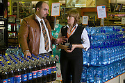 Moscow, Russia, 09/11/2007..Pepsi representatives with various Pepsi brand displays at the Ramstore City hypermarket. Territorial Sales Manager Aexander Druzhinin [left] and Ramstore Deputy Administrator Natalia Gamii.
