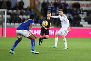 Gylfi Sigurdsson of Swansea city ® passes the ball. Barclays Premier league match, Swansea city v Leicester city at the Liberty stadium in Swansea, South Wales on Saturday 25th October 2014<br /> pic by Andrew Orchard, Andrew Orchard sports photography.
