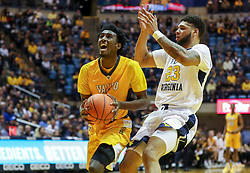 Nov 24, 2018; Morgantown, WV, USA; Valparaiso Crusaders guard Javon Freeman (0) drives down the lane while defensed by West Virginia Mountaineers forward Esa Ahmad (23) during the first half at WVU Coliseum. Mandatory Credit: Ben Queen-USA TODAY Sports