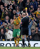 Photo. Glyn Thomas, Digitalsport<br /> Norwich City v Manchester United.<br /> Barclays Premiership. 09/04/2005.<br /> Norwich's Leon McKenzie (L) is shown the yellow card for removing his shirt in celebration of his goal.