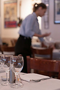 A waitress lays tables at Ciao Bella Italian restaurant on the 27th September 2019 in London in the United Kingdom.