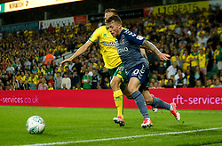 Charlton Athletic's Billy Clarke and Norwich City's Marco Stiepermann battle for the ball