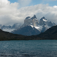 The Horns of Paine rise above Paine River in Torres del Paine National Park, Patagonia, Chile.