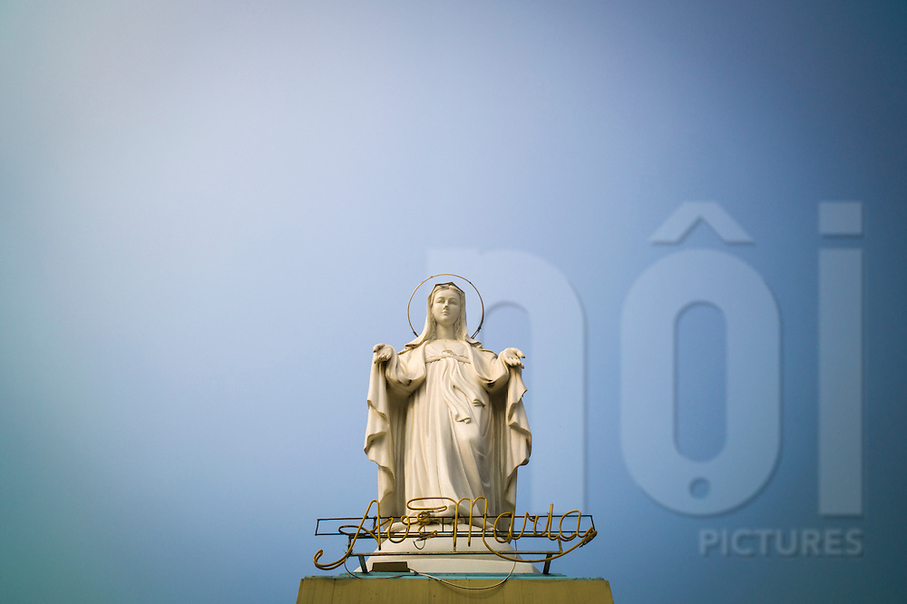 Statue of the Virgin Mary and an Ave Maria sign atop Phu Oc Church, Nam Dinh City, Nam Dinh Province, Vietnam, Southeast Asia