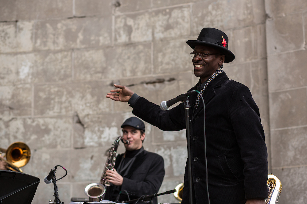 A smiling sax player wraps up the concert for the Mingus Big Band.