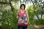Anne Emerson poses for a portrait with a photo of her late fiancée, Ryan, in downtown Coon Rapids, Minnesota, on Wednesday, June 9, 2021. Emerson, who is in recovery for substance abuse, counsels four people addicted to opioids through the Recovery Advocacy Project.