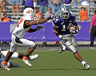 Kansas State running back Leon Patton (14) rushes past Oklahoma State defensive back Jacob Lacey (17) in the first half at Bill Snyder Family Stadium in Manhattan, Kansas, October 7, 2006.  The Wildcats beat the Cowboys 31-27.<br />