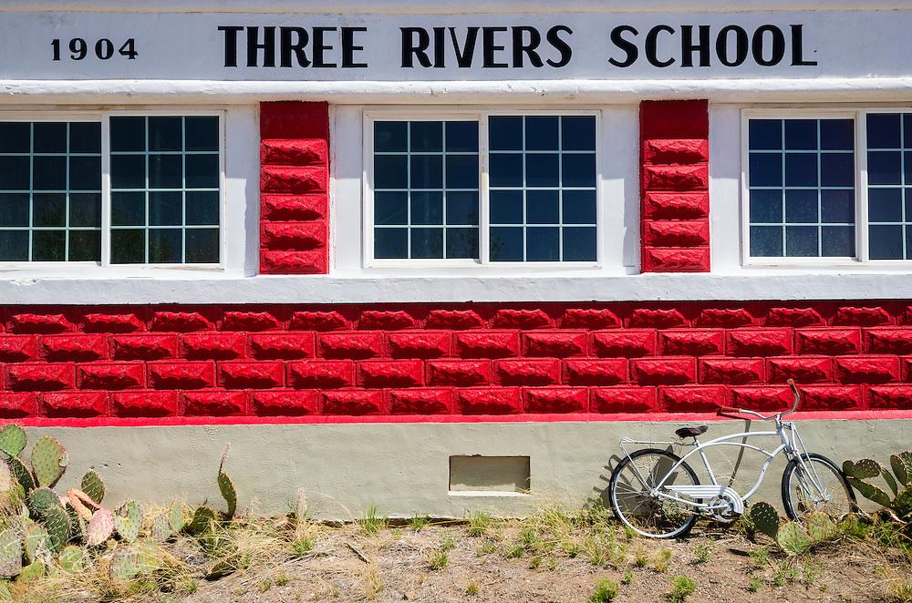 The historic red brick Three Rivers Schoolhouse, Three Rivers, New Mexico USA