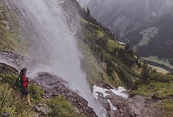 THEMENBILD - eine Frau steht auf einem Weg hinter dem Wasserfall waehrend einer Wanderung entlang des Wasserfallweges, aufgenommen am 28. Juli 2019 in Fusch a. d. Grossglocknerstrasse, Oesterreich // a Women stands on a trail behind the waterfall while hiking along the waterfall trail in Fusch a. d. Grossglocknerstrasse, Austria on 2019/07/28. EXPA Pictures © 2019, PhotoCredit: EXPA/ JFK