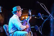 Hunter Holmes playing the guitar at the Brooklyn Folk Festival.