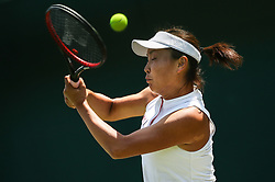 LONDON, July 3, 2018  Peng Shuai of China hits a return during the women's singles first round match against Samantha Stosur of Australia at the Championship Wimbledon 2018 in London, Britain, on July 3, 2018. Peng Shuai lost 0-2. (Credit Image: © Tang Shi/Xinhua via ZUMA Wire)