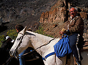 Grant riding horse out of the Grand Canyon on the Whitmore Trail at the conclusion of a Grand Canyon Dories trip, Grand Canyon National Park, Arizona.