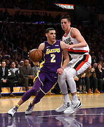 December 23, 2017 - Los Angeles, California, U.S. - Los Angeles Lakers guard Lonzo Ball (2) controls the ball past Portland Trail Blazers center Zach Collins (33) in the second half of a NBA Basketball game at Staples Center on Saturday, Dec. 23, 2017 in Los Angeles. Portland Trail Blazers won 95-92. (Credit Image: © Keith Birmingham/SCNG via ZUMA Wire)