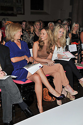 Left to right, SOPHIE RAWORTH and KIMBERLEY WALSH at a fashion show by Catherine Walker & Co in support of The Haven held at One Mayfair, North Audley Street, London on 18th May 2011.