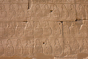 Detail of hieroglyphs showing ancient armies at the Temple of Amun at Karnak, Luxor, Nile Valley, Egypt. The Karnak Temple Complex is the largest religious building ever made, covering about 200 acres. It comprises a vast mix of decayed temples, chapels, pylons, and other buildings built over 2,000 years and dedicated to the Theban triad of Amun, Mut, and Khonsu.