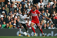 Cyrus Christie of Middlesbrough (R) takes on Ryan Sessegnon of Fulham (L). EFL Skybet championship match, Fulham v Middlesbrough at Craven Cottage in London on Saturday 23rd September 2017<br /> pic by Steffan Bowen, Andrew Orchard sports photography.