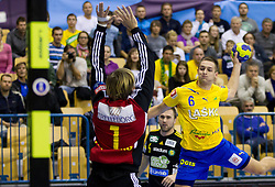 Thomas Forsberg of Savehof vs Gasper Marguc of Celje during handball match between RK Celje Pivovarna Lasko and IK Savehof (SWE) in 3rd Round of Group B of EHF Champions League 2012/13 on October 13, 2012 in Arena Zlatorog, Celje, Slovenia. (Photo By Vid Ponikvar / Sportida)